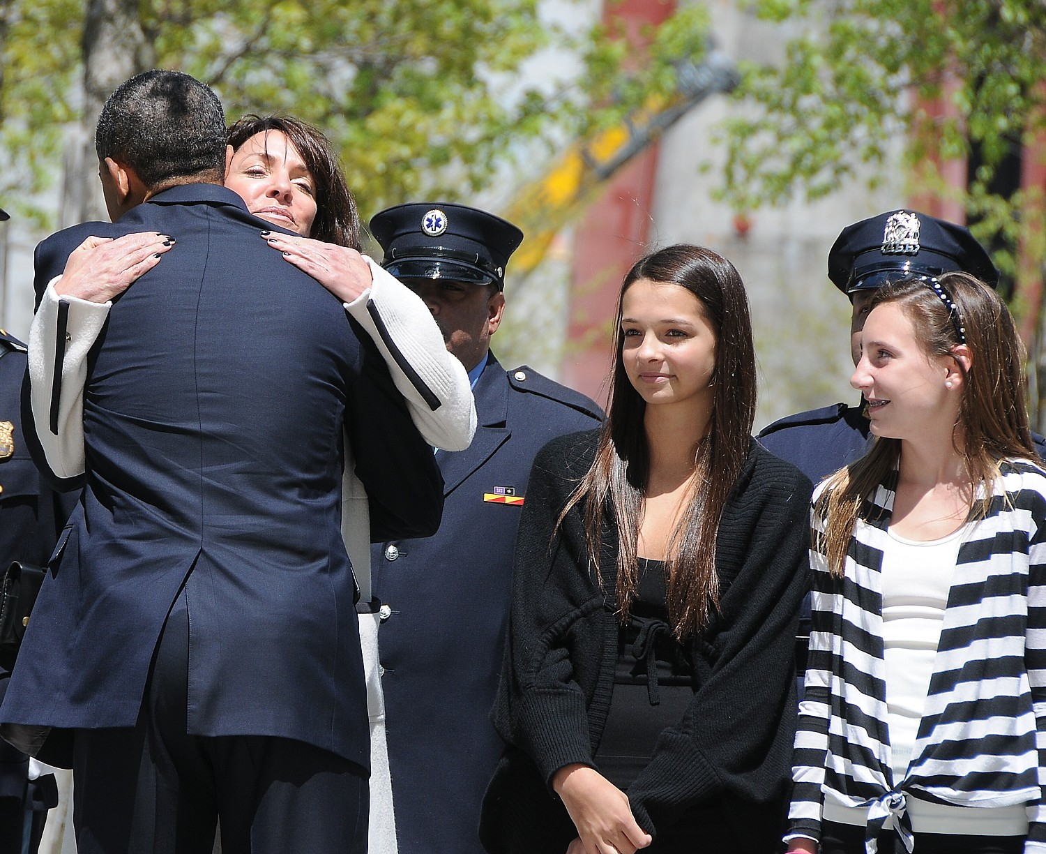President Obama with Diane Wall and her family who lost family in the September 11 attacks, at dedication of September 11 Memorial. New York City, May 2011 © 2016 Karen Rubin/news-photos-features.com